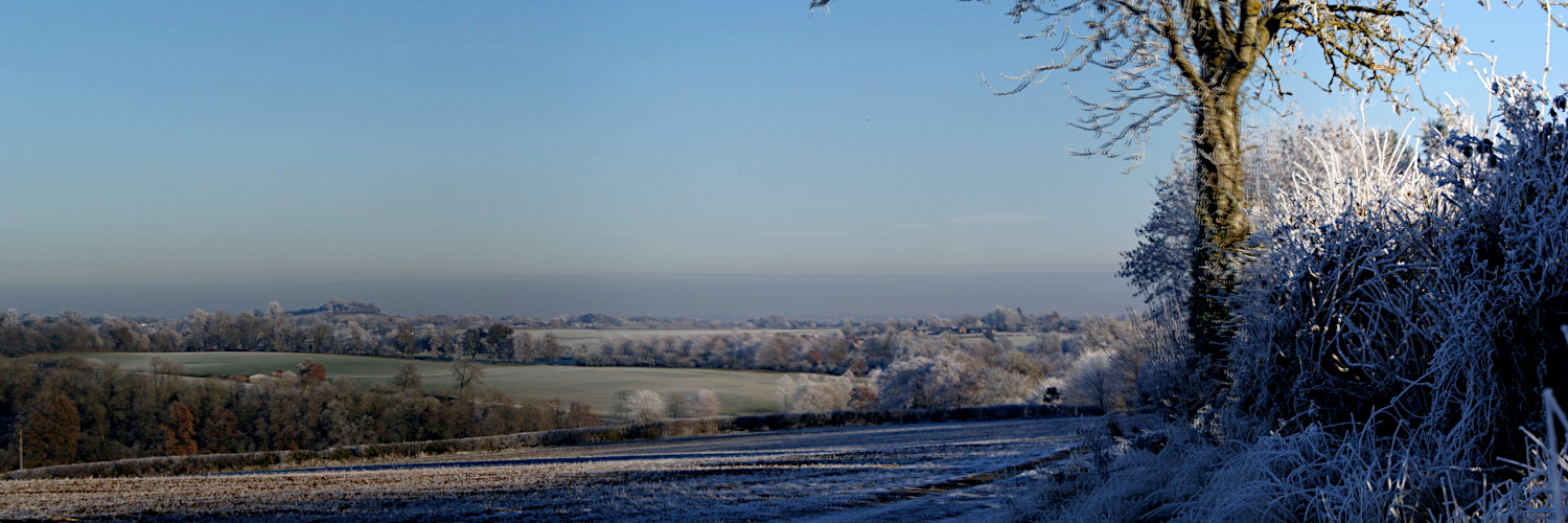 Landscape image, 'A frosty Crouch Hill, viewed from where Salt Way beyond Fulling Mill'